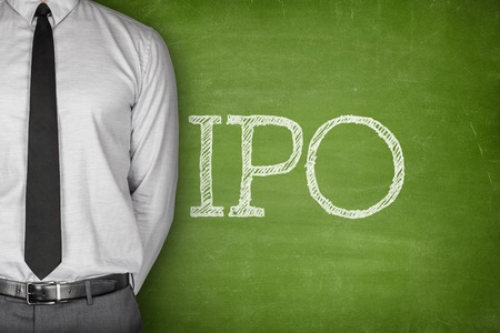 public offering: IPO or Initial public offering text on blackboard with businessman on side Stock Photo