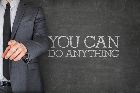 anything: You can do anything on blackboard with businessman finger pointing