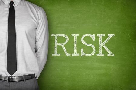 bewegung menschen: Risk concept on blackboard with businessman on side Lizenzfreie Bilder