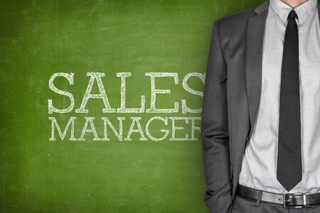 sales manager: Sales manager on blackboard with businessman on side Stock Photo