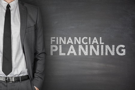 cashflow: Financial planning text on black blackboard with businessman