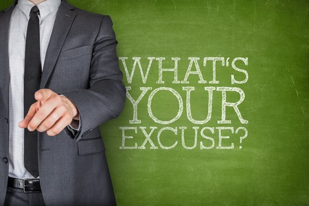 pardon: Whats your excuse on blackboard with businessman finger pointing