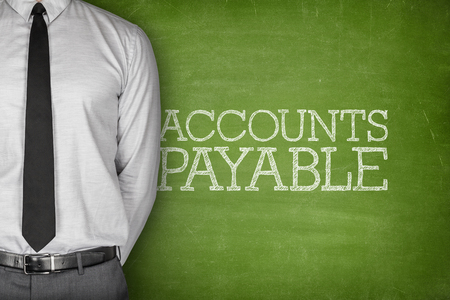 accounts payable: Accounts payable text on blackboard with businessman on side