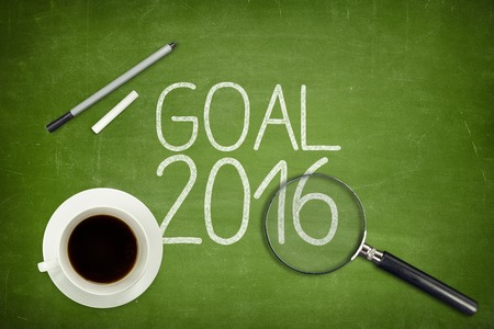 estimating: Goal 2016 concept on green blackboard with empty paper sheet and coffee cup