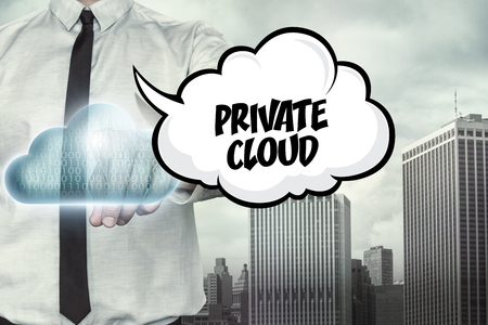 private cloud: Private cloud text on cloud computing theme with businessman on cityscape background Stock Photo
