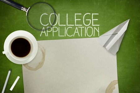 university application: College application concept on green blackboard with empty paper sheet and coffee cup