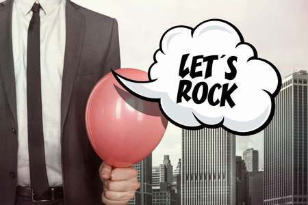 lets party: text on speech bubble with businessman holding balloon on cityscape background Stock Photo