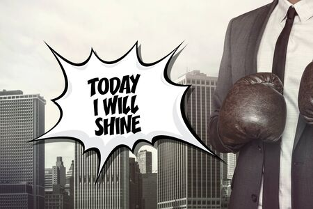 excel: Today i will shine text with businessman wearing boxing gloves on cityscape background Stock Photo