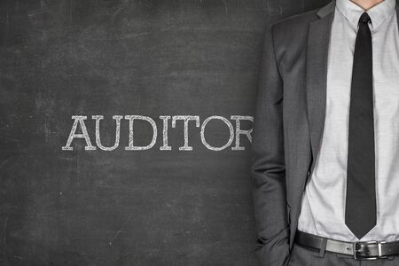 auditor: Auditor on blackboard with businessman in a suit on side