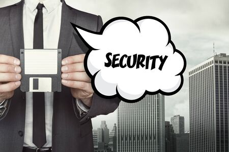 backing: Security tex on speech bubble with businessman holding diskette on cityscape background Stock Photo