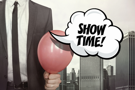 show time: Show time text on speech bubble with businessman holding balloon on cityscape background