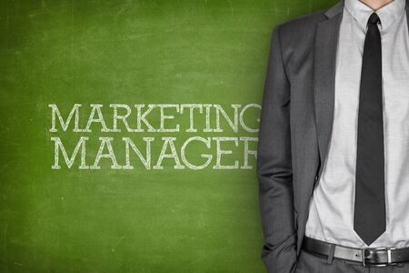 specialized job: Marketing manager on blackboard with businessman in a suit on side