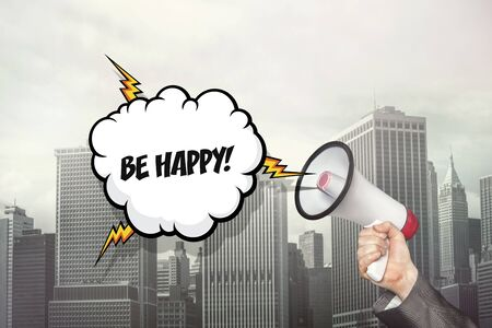Be happy text on speech bubble and businessman hand holding megaphone on cityscape background