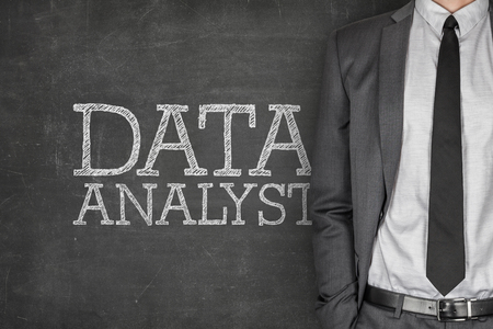 proficient: Data analyst on blackboard with businessman in a suit on side Stock Photo