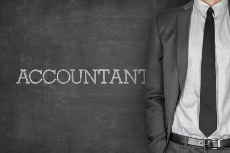 Accountant on blackboard with businessman in a suit on side