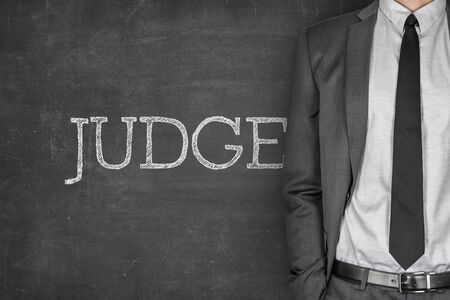 specialized job: Judge on blackboard with businessman in a suit on side
