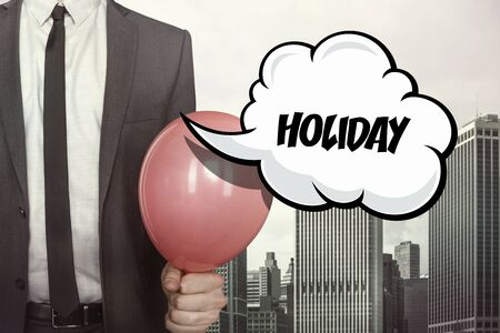 jovial: Holiday text on speech bubble with businessman holding balloon on cityscape background