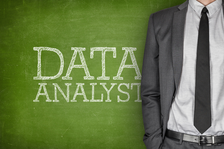 specialized job: Data analyst on blackboard with businessman in a suit on side Stock Photo