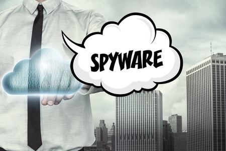 spyware: Spyware text on cloud computing theme with businessman on cityscape background Stock Photo