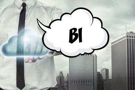 bi: BI text on cloud computing theme with businessman on cityscape background