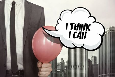 dedicate: I think I can text on speech bubble with businessman holding balloon on cityscape background Stock Photo