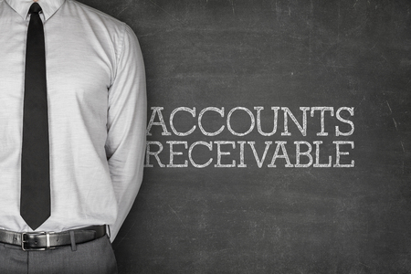 attaining: Accounts receivable text on blackboard with businessman on side