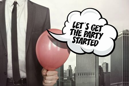 lets party: Lets get the party started text on speech bubble with businessman holding balloon on cityscape background Stock Photo