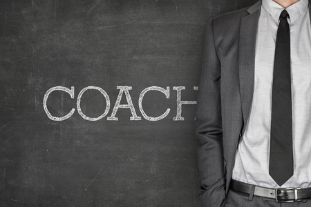 specialized job: Coach on blackboard with businessman in a suit on side