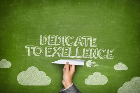 contribute: Dedicate to excellence concept on green blackboard with businessman hand holding paper plane