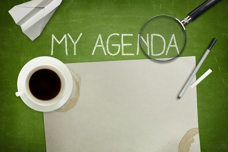 meeting agenda: My agenda concept on green blackboard with empty paper sheet and coffee cup Stock Photo