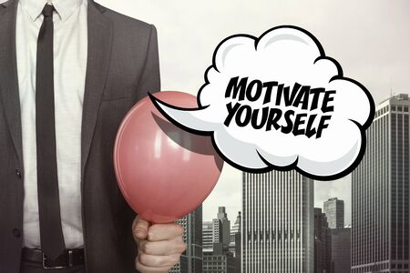 provoke: Motivate yourself text on speech bubble with businessman holding balloon on cityscape background