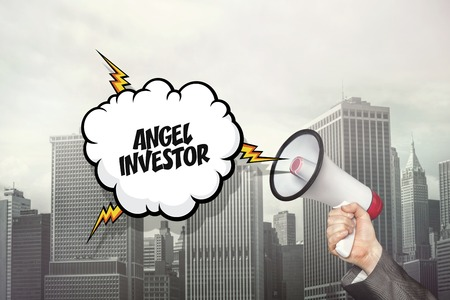 angels: Angel investor text on speech bubble and businessman hand holding megaphone on cityscape background