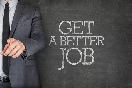 better chances: Get a better job on blackboard with businessman finger pointing Stock Photo