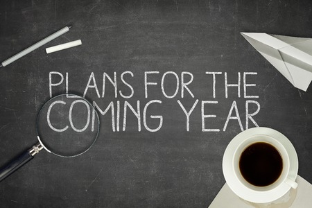 coming: Plans for the coming year concept on blackboard with coffee cup Stock Photo