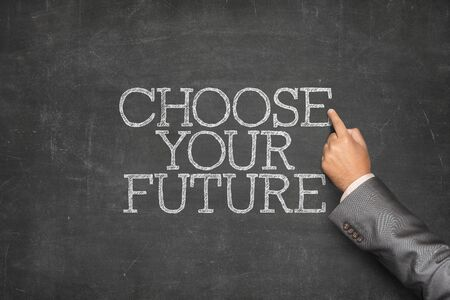 imminent: Choose your future text on blackboard with businessman hand pointing Stock Photo