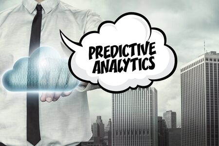 predictive: Predictive analytics text on cloud computing theme with businessman on cityscape background Stock Photo