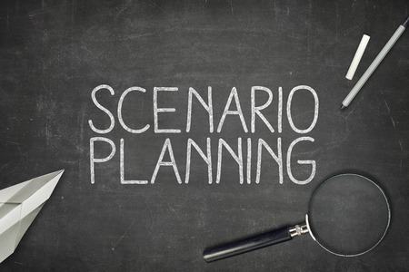 Scenario planning concept on blackboard with magnifying glass