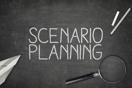 scenario: Scenario planning concept on blackboard with magnifying glass