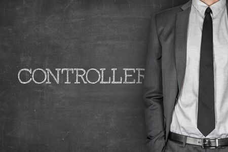 specialized job: Controller on blackboard with businessman in a suit on side Stock Photo