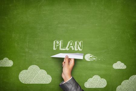 formulation: Plan concept on green blackboard with businessman hand holding paper plane