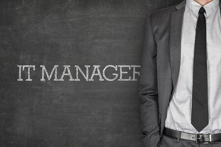 proficient: IT manager on blackboard with businessman in a suit on side Stock Photo