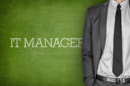 IT manager on blackboard with businessman in a suit on side Stock Photo