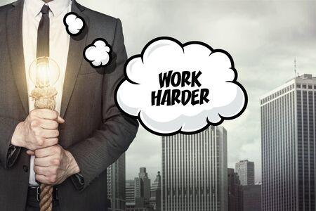 harder: Work harder text on speech bubble with businessman holding lamp on city background