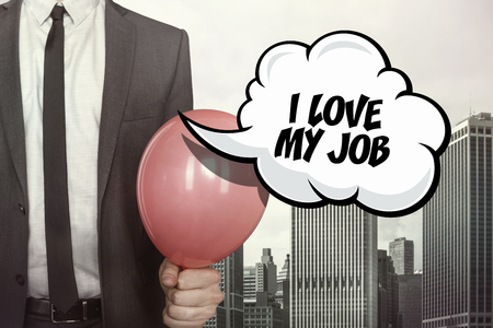 adoration: I love my job text on speech bubble with businessman holding balloon on cityscape background