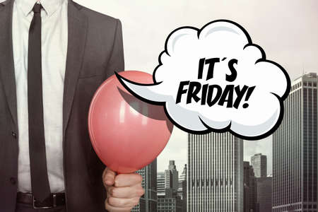it's: Its friday text on speech bubble with businessman holding balloon on cityscape background Stock Photo