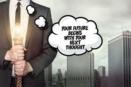 begins: Your future begins with your next thought text on speech bubble with businessman holding lamp on city background