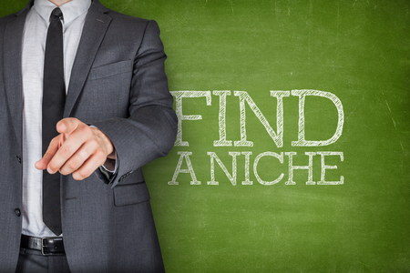 niche: Find a niche on blackboard with businessman finger pointing