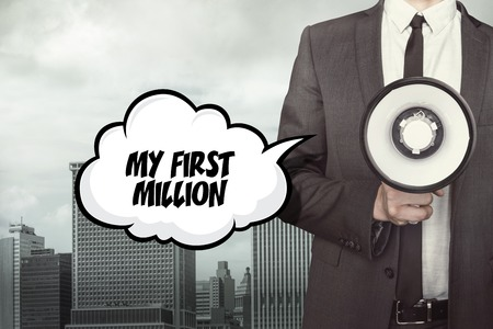 million: My first million text on speech bubble with businessman and megaphone on city background