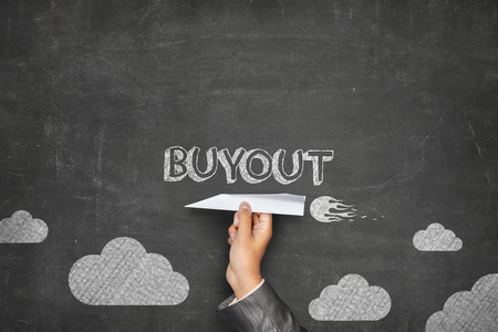 overthrow: Buyout concept on black blackboard with businessman hand holding paper plane Stock Photo