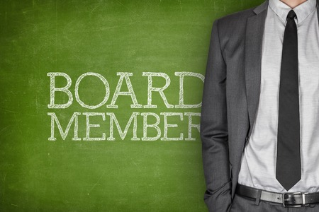 regulating: Board member on blackboard with businessman in a suit on side Stock Photo